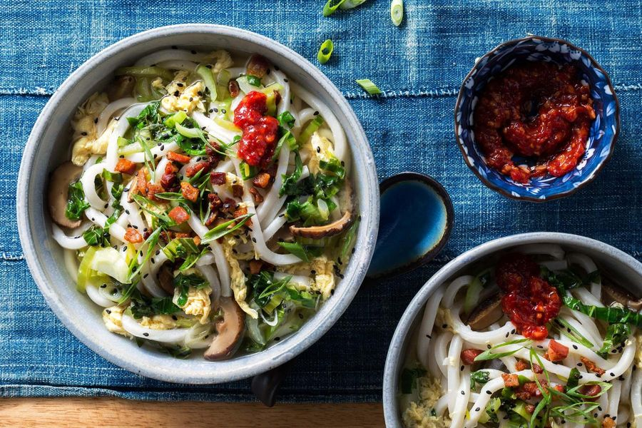 Japanese-style egg drop soup with udon, pancetta, and bok choy