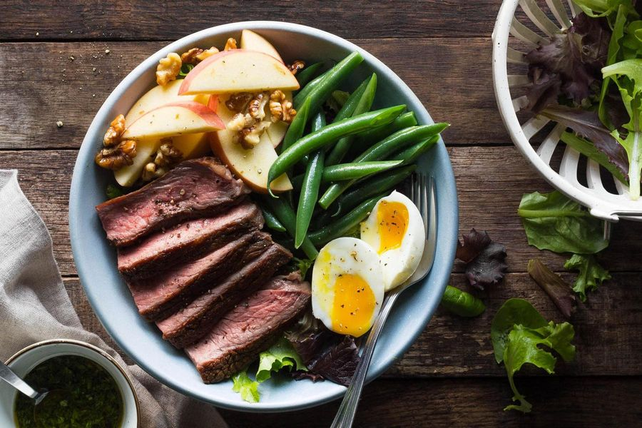 Steak salad with apples, green beans, and soft-cooked eggs