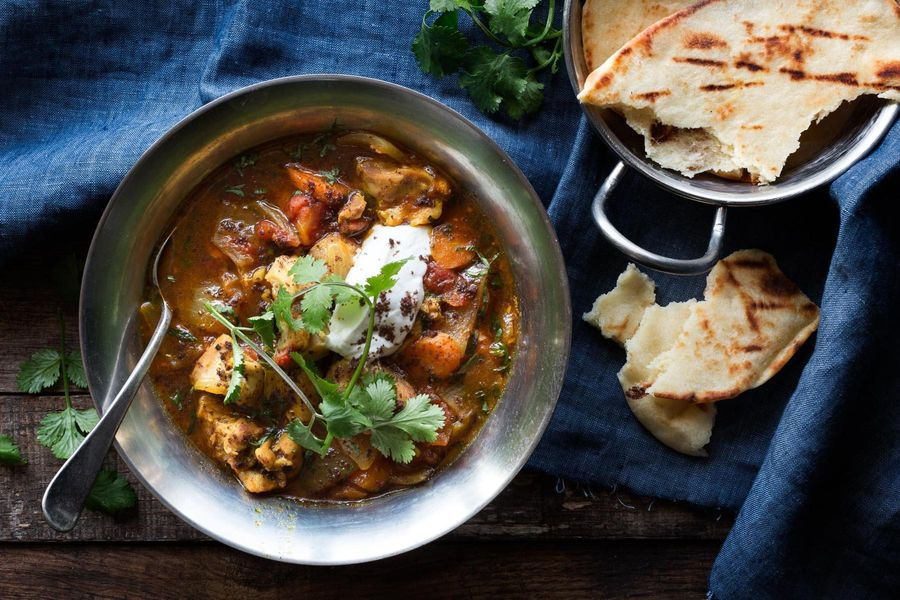 Chicken garam masala with yogurt and toasted naan