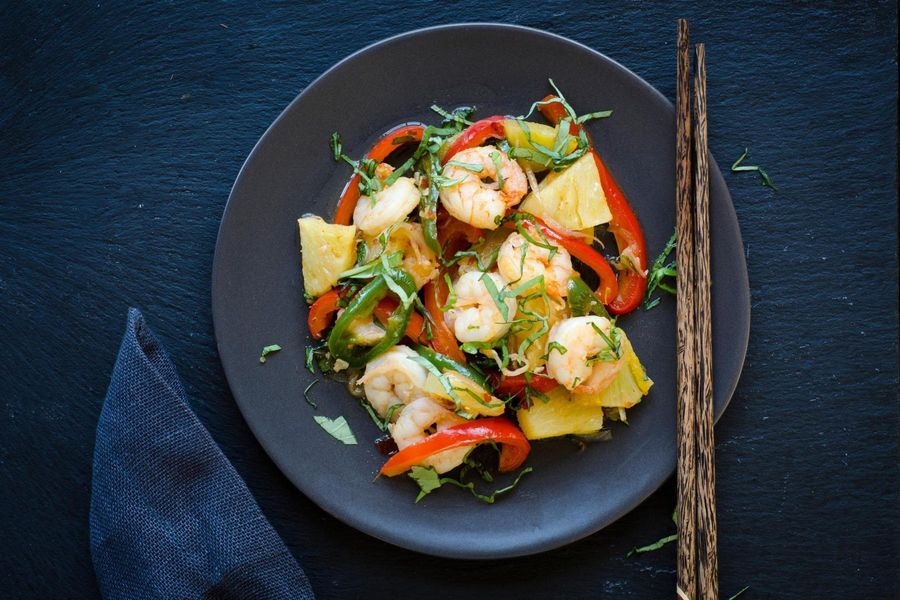 Spicy stir-fried shrimp with pineapple, bell pepper and Thai basil