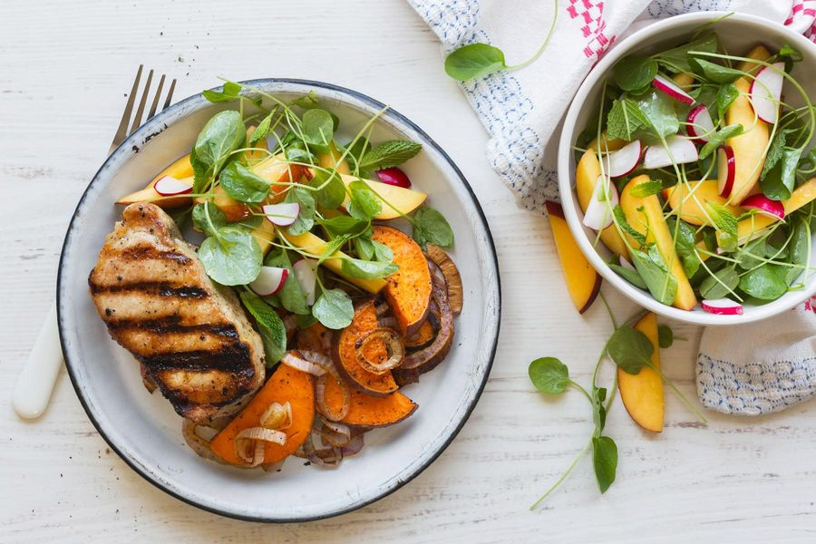 Grilled pork with roasted sweet potatoes and nectarine-watercress salad