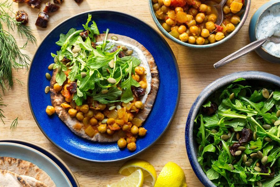 Pita flatbreads with curried chickpeas and arugula-date salad