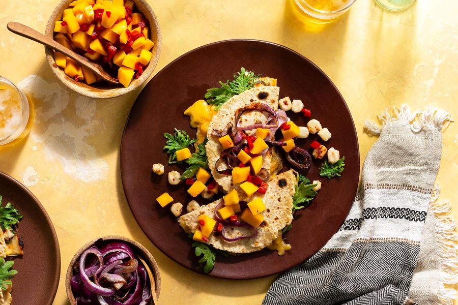 Hominy and kale quesadillas with mango salsa and caramelized onion