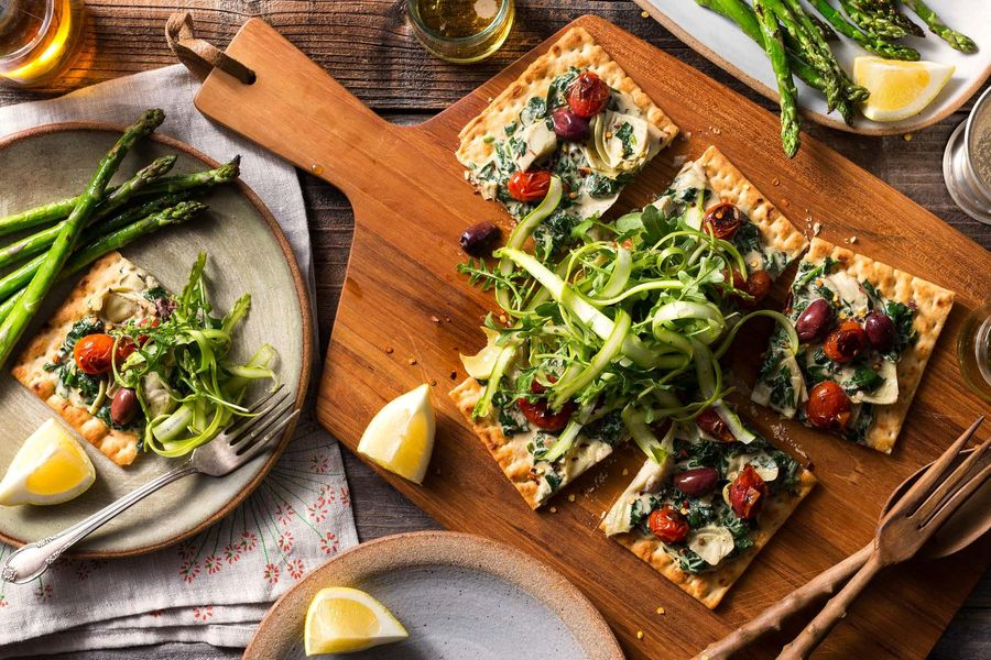 Spinach-artichoke flatbreads with shaved asparagus salad