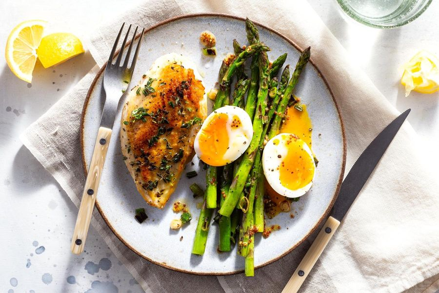 Herbed chicken with sautéed asparagus and soft-cooked eggs