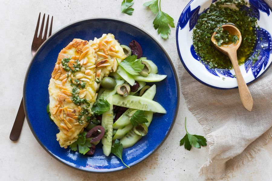 Almond-crusted cod with chermoula and cucumber-olive salad