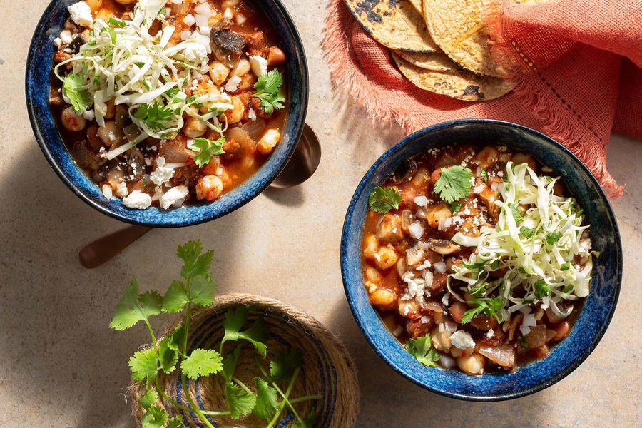 Pinto bean and hominy pozole rojo with warm tortillas