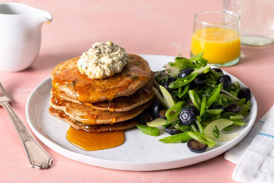 Savory sweet pea pancakes with lemon ricotta and blueberry slaw