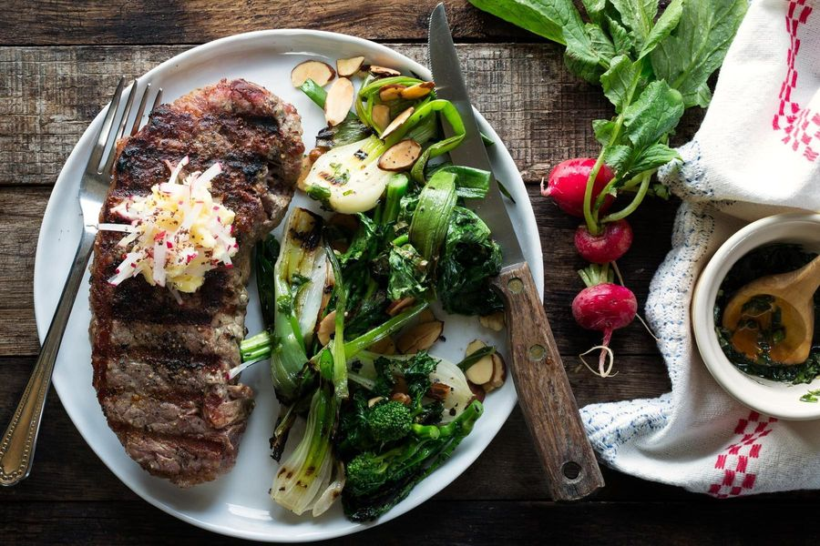 Grilled steaks with broccoli rabe and radish butter