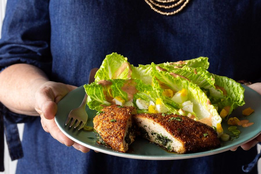 Chicken Kiev and Russian salad with hard-cooked eggs and scallions