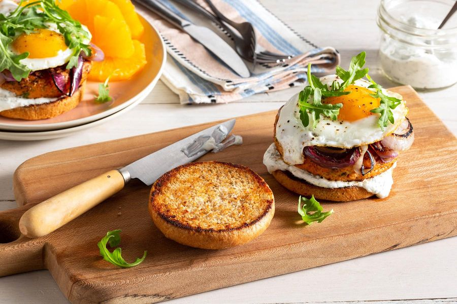 Salmon burgers with fried eggs and dill yogurt