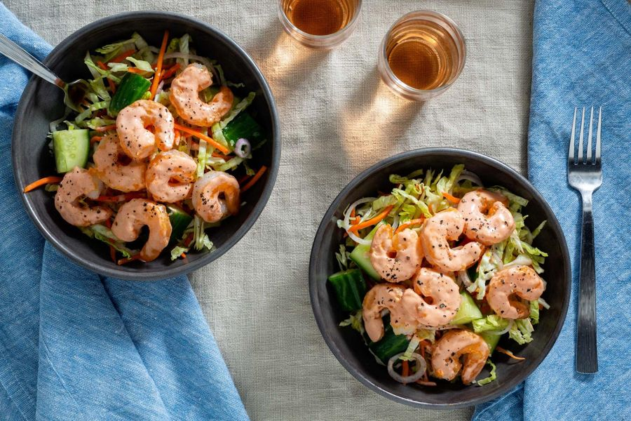 Spicy shrimp over smashed cucumber salad
