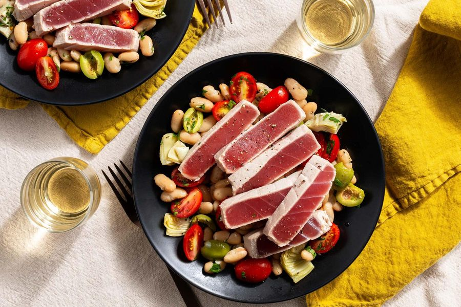 Albacore tuna poached with lemon and rosemary over white bean salad