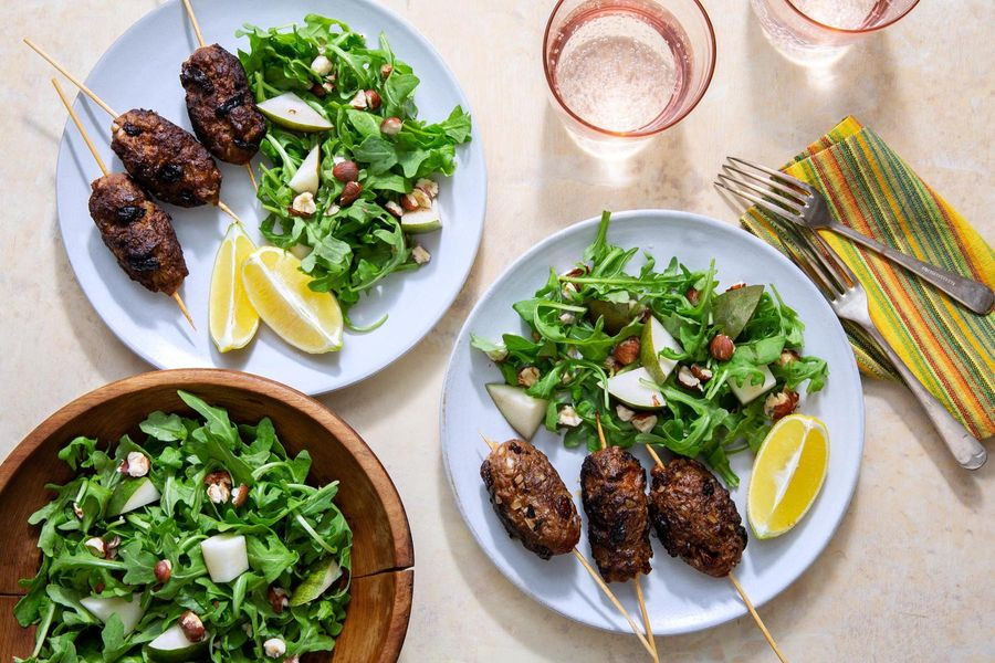 Greek beef skewers with arugula-pear salad and hazelnuts