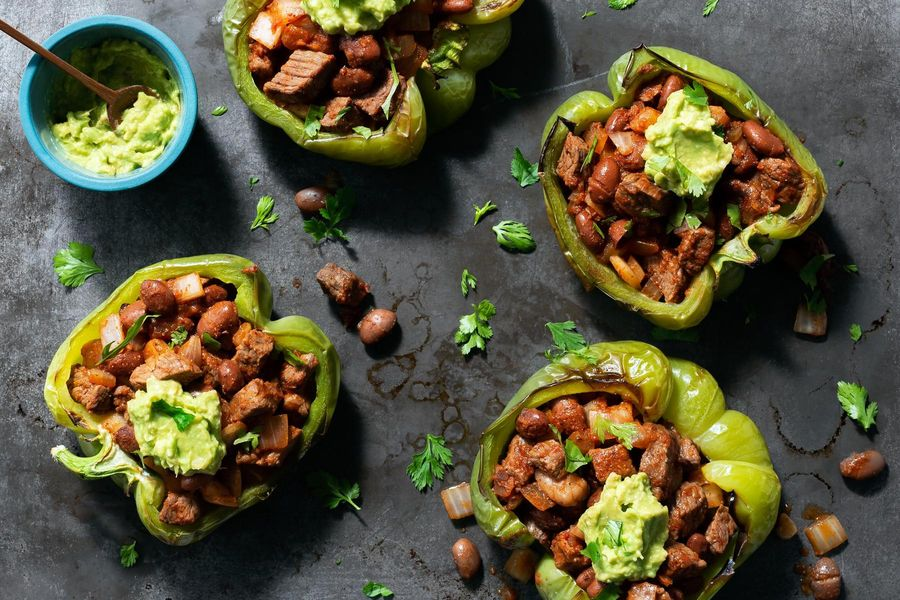 Steak-stuffed peppers with pinto beans and guacamole