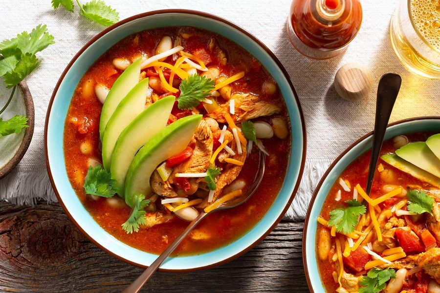 Chicken and white bean chili with avocado and cheese
