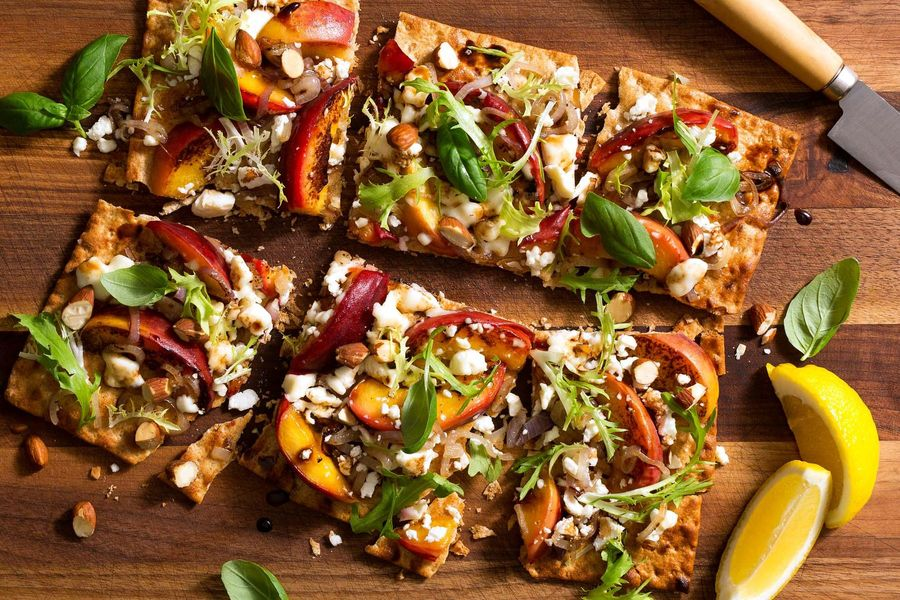Charred peach and feta flatbreads with frisée salad