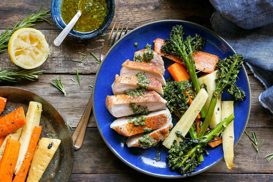 Seared pork loins with rosemary-roasted winter vegetables and chermoula