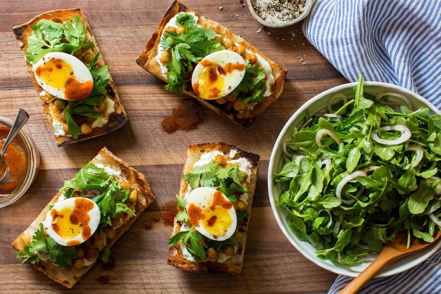Chickpea tartines with soft-cooked eggs and arugula salad