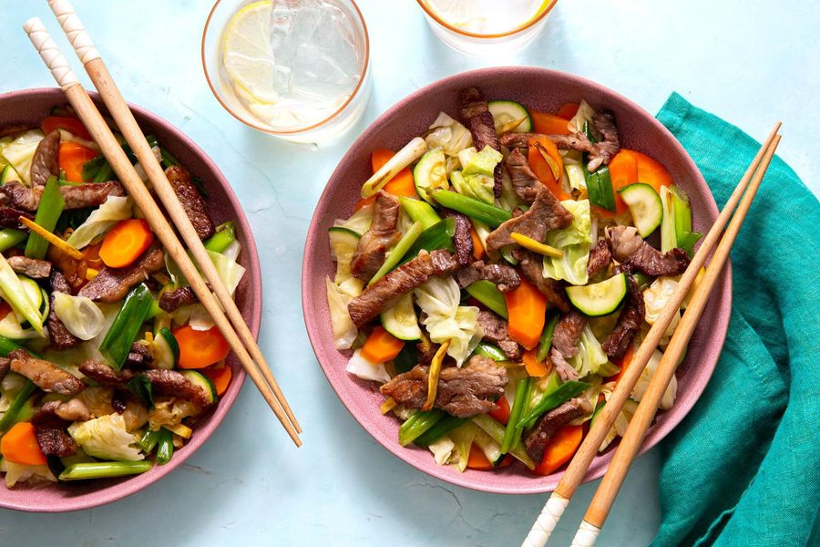 Gingered steak stir-fry with steamed vegetables