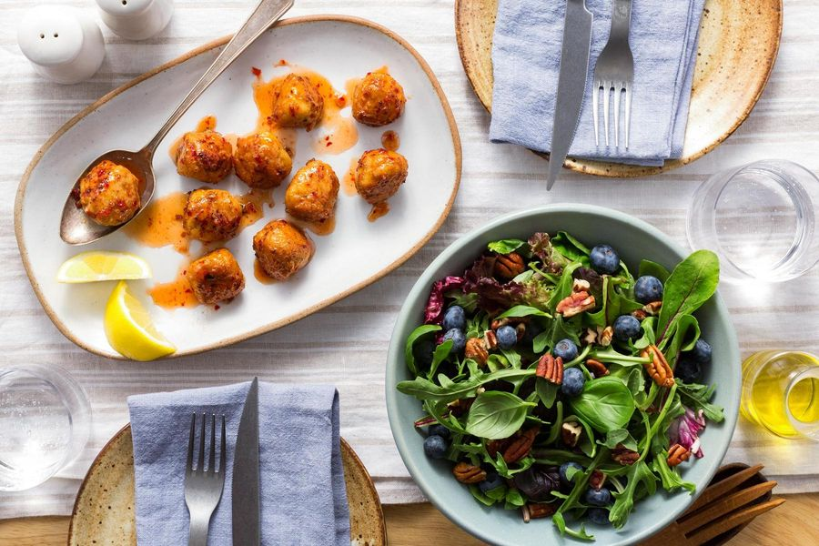 Sweet and spicy chicken meatballs with blueberry-pecan salad