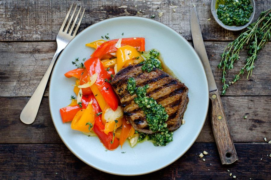 Grilled sirloins with piperade and arugula pesto