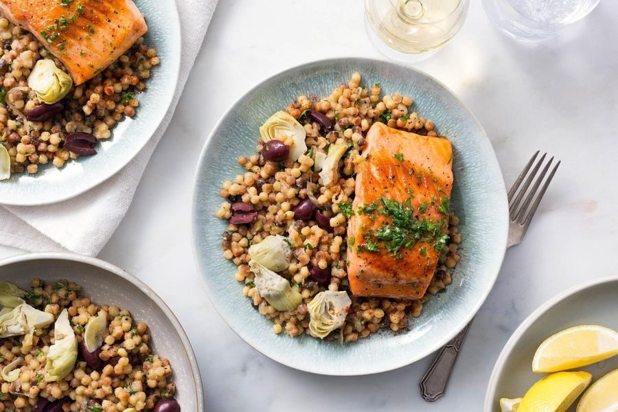 Salmon with lemon-oregano sauce and artichoke-fregola pilaf