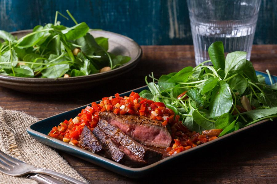 Pan-seared steak with ajvar red pepper relish and watercress