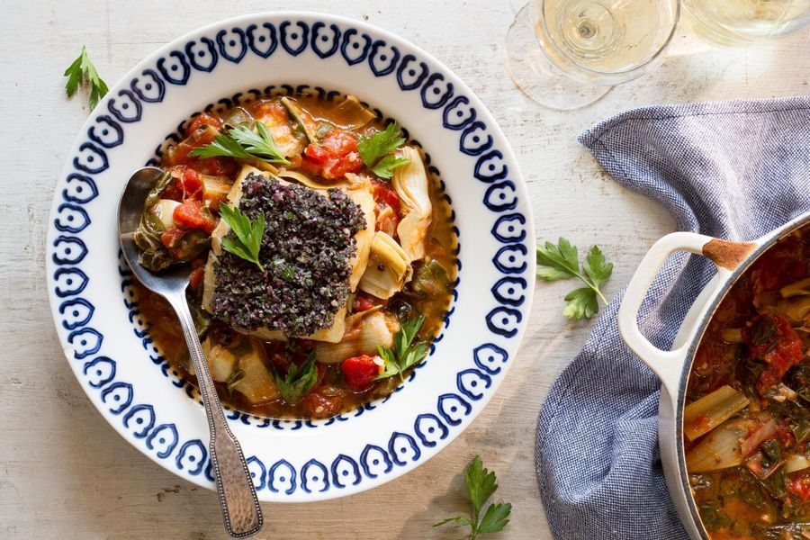 Braised cod with tomatoes, chard, artichokes, and olives