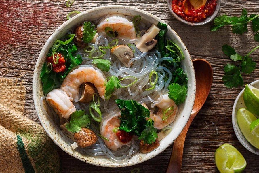 Lemongrass shrimp soup with mushrooms, kale, and glass noodles