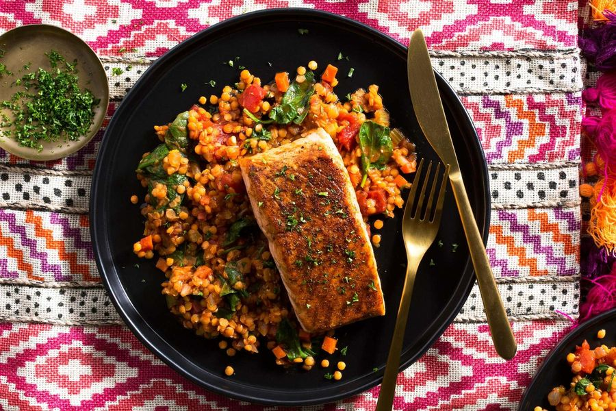 Moroccan salmon with stewed tomatoes, lentils, and baby spinach