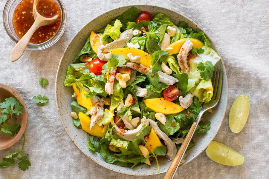 Mango chicken salad with cashews and basil