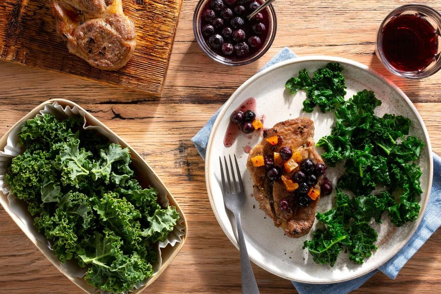 Pork blade steaks with blueberry-apricot sauce and sautéed kale