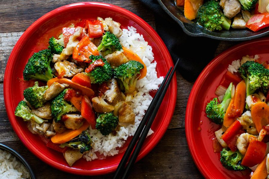 Orange chicken and vegetable stir-fry with jasmine rice