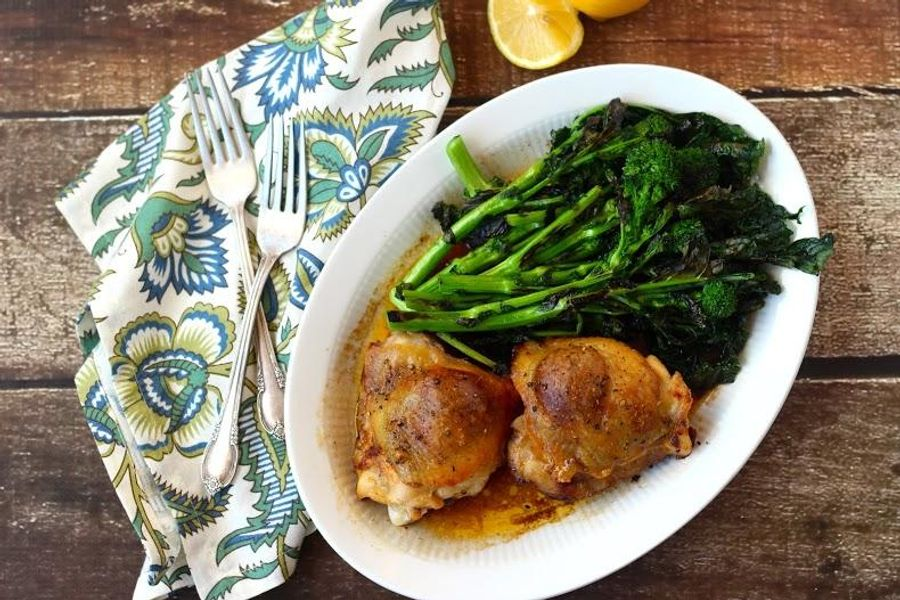 Baked chicken with herbed butter and rapini