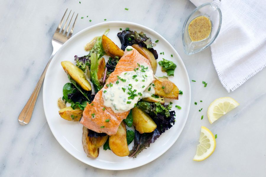 Salmon with roasted potatoes, field greens salad and chive creme fraiche