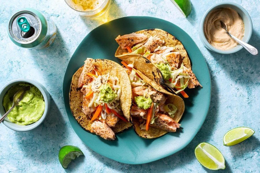 Salmon tacos with cabbage slaw, guacamole, and chipotle yogurt
