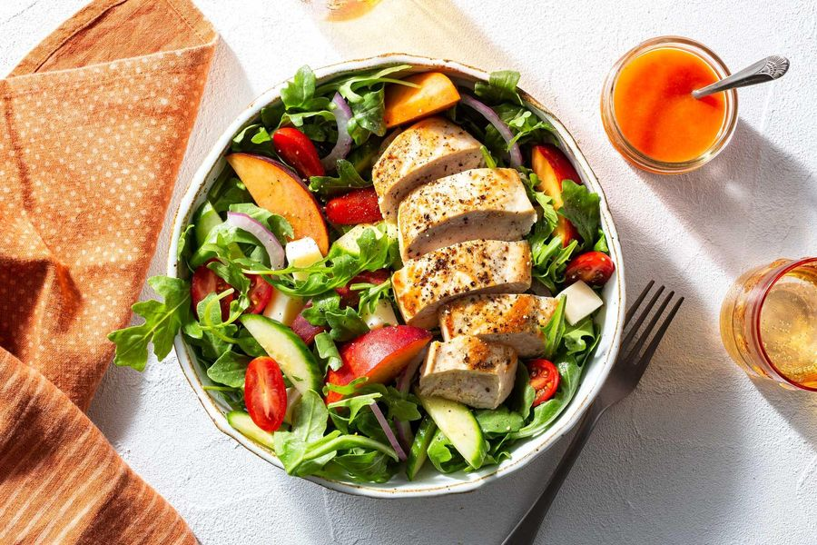 Chicken breasts with peach caprese salad and red pepper vinaigrette