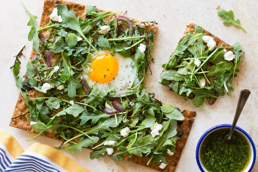 Flatbreads with goat cheese, soft-cooked eggs, and arugula
