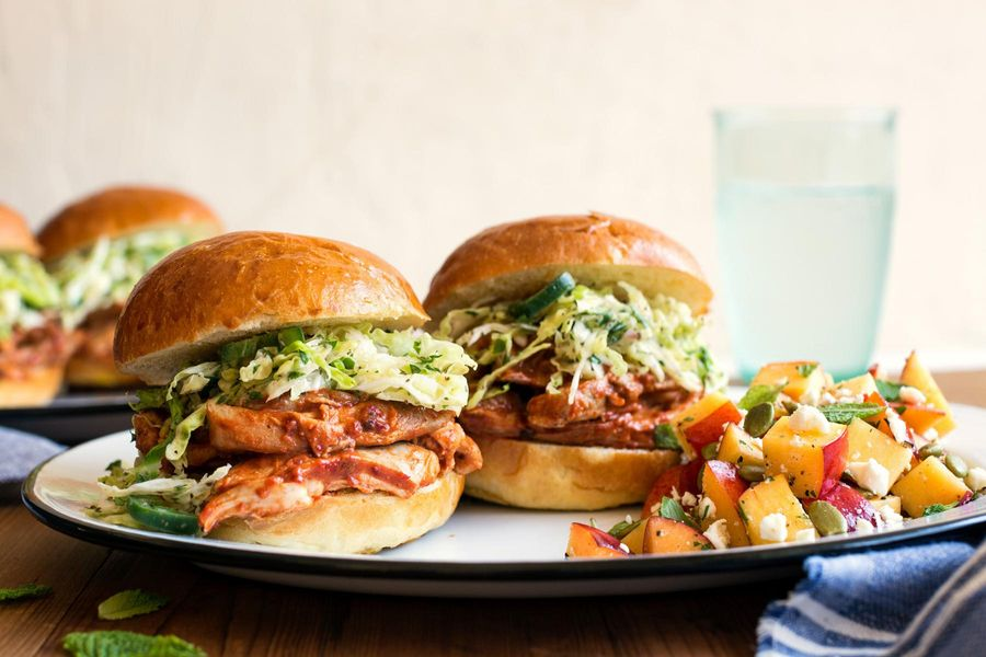 Barbacoa chicken sliders with cabbage slaw and peach-feta salad