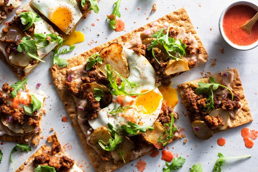 Chorizo flatbreads with sunchokes and sunny-side up eggs