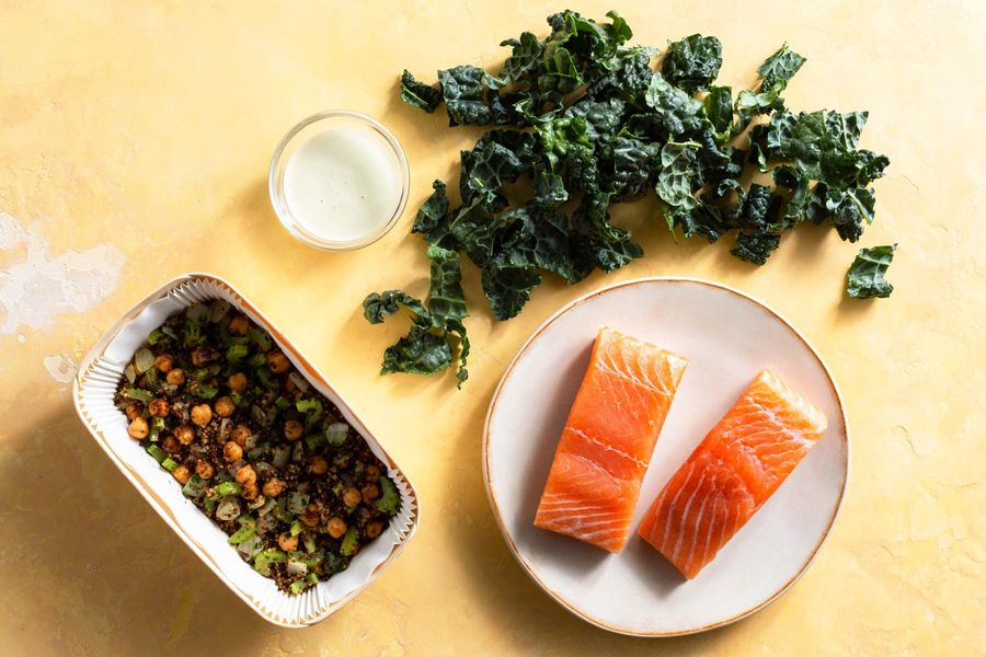 Salmon and quinoa bowls with wilted greens and citrus dressing