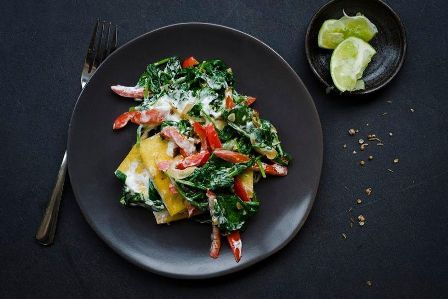 Cumin-spiced tofu and bell peppers with spinach and greek yogurt