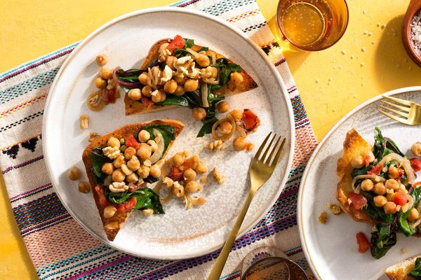 Moroccan-spiced chickpeas and wilted chard on garlic toasts