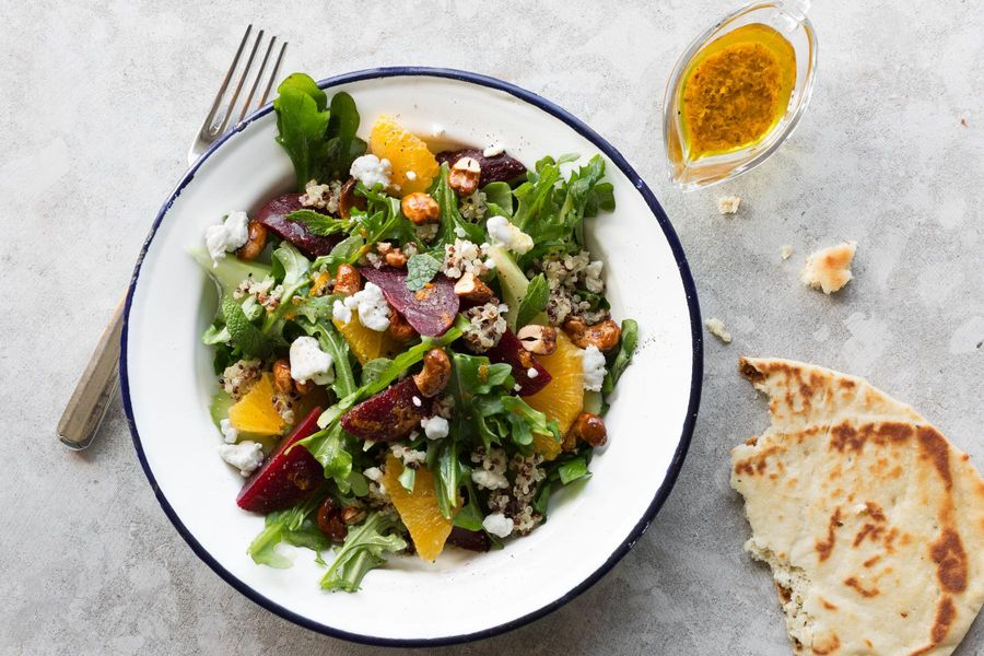 Beet, orange, and quinoa salad with goat cheese and curry vinaigrette