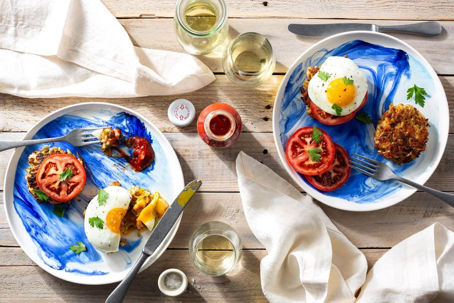 Maine fish cakes with fried eggs and tomato