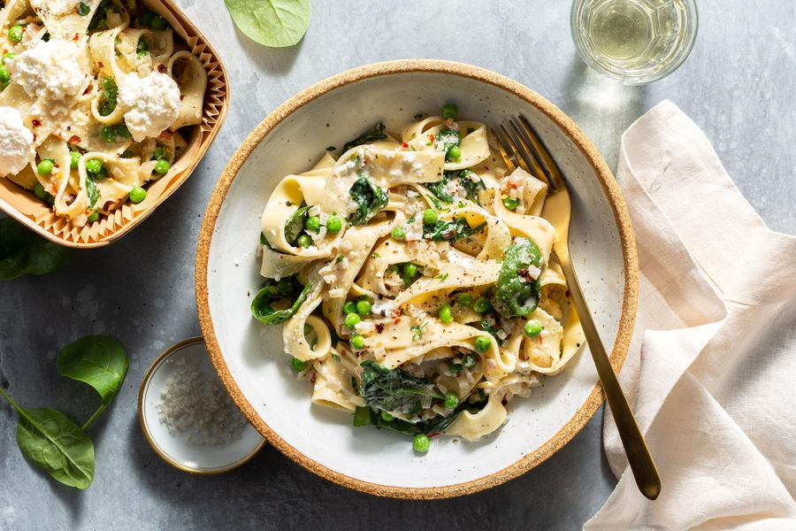 Pappardelle with wilted spinach, sweet peas, and fresh ricotta