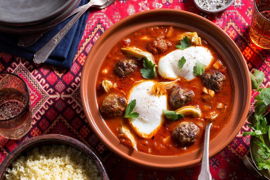 Moroccan lamb tagine with artichokes, tomato-poached eggs, and couscous