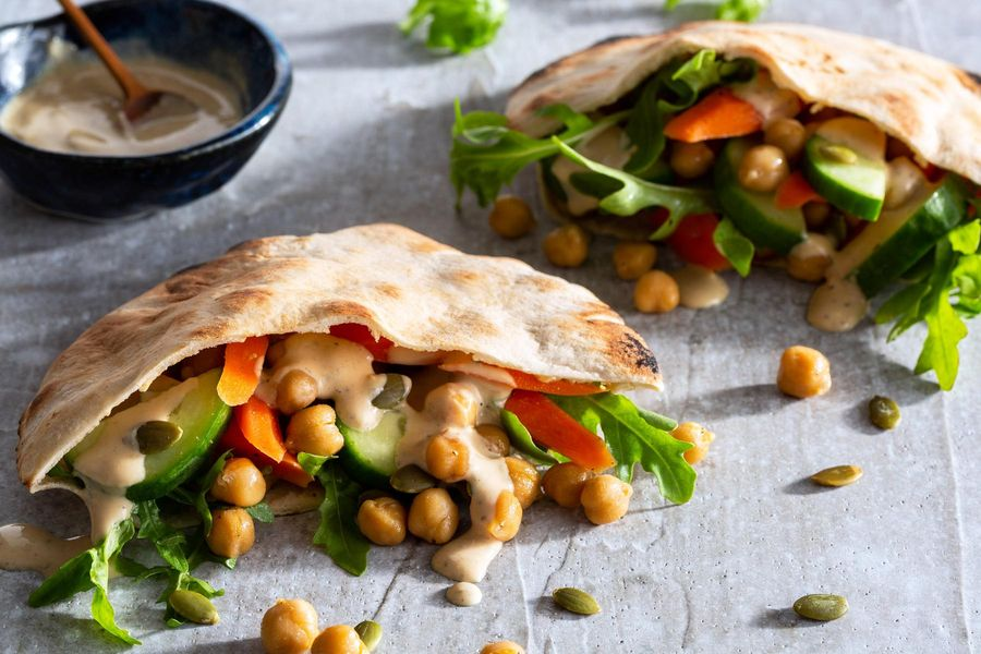 Chickpea and carrot pita pockets with cumin-lime tahini
