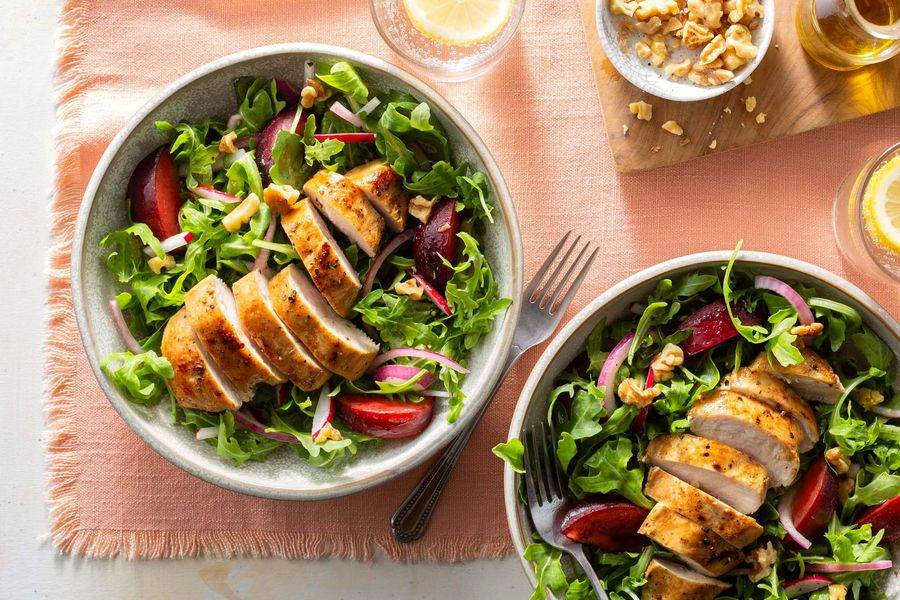 Summer chicken salad with charred plum, arugula, and walnuts